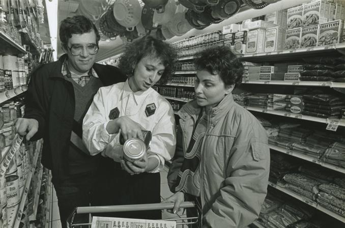 NYANA - 3 - 1980s - NYANA Staff helping refugees in super market.jpg
